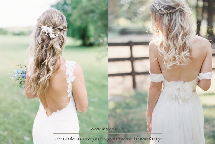 Acconciature sposa: capelli lunghi in un semiraccolto con onde e fermaglio di fiori